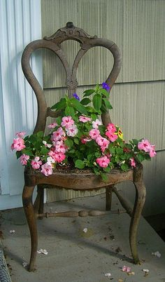 Upcycled: vintage old chair repurposed into garden planter for cottage front porch; Upcycle, Recycle, Salvage, diy, thrift, flea, repurpose!  For vintage ideas and goods shop at Estate ReSale & ReDesign, Bonita Springs, FL