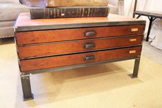 Custom coffee table created with vintage printer's drawers at http://www.chartreuseandco.com/tagsale.html