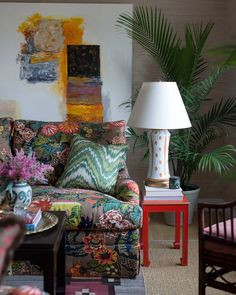 a living room layered with art and texture