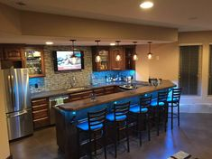 DIY basement bar fitted with concrete countertops.