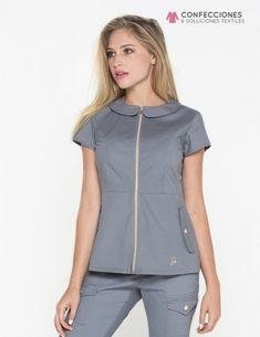 The Peter Pan Top in Graphite is a contemporary addition to women& medical scrub outfits. Shop Jaanuu for scrubs, lab coats and other medical apparel. Spa Uniform, Scrubs Uniform, Nursing Wear, Nursing Clothes, Stylish Scrubs, Scrubs Outfit, Medical Scrubs, Nursing Scrubs, Medical Uniforms