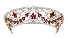 Possibly the best known garnet tiara, formerly belonging to Countess Ruth Rosenborg of Denmark. A kokoshnic with swags of garnet leaves and flower heads, with diamond foliate scrolls and bows, with button pearls. Royal Crowns, Royal Tiaras, Tiaras And Crowns, Royal Jewelry, Vintage Jewelry, Fine Jewelry, Faberge Eier, Diamond Tiara, Pearl Diamond