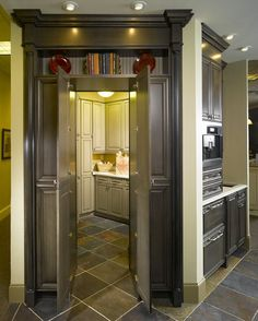 Hidden Laundry Room. THAT is pretty cool. It would also be a great panty. ♥ this house!