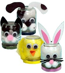 """Clean baby food jar. Remove label. Fill with pompoms to match your animal's face. Put the lid on and turn it upside down. Glue on wiggle eyes. Cut ears (or beak) out of foam and glue in place. Add pompoms if desired. For whiskers, cut pieces of craft lace and glue one end under pompom nose.    Cut a strip of craft foam 1/4"""" wide and glue around edge of lid."""