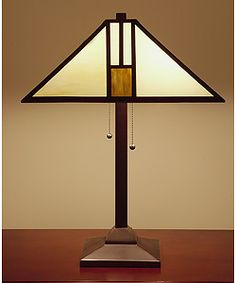 @Overstock - These white Tiffany style table lamps have an intricate design that creates a chic look. The shade is made of stained glass and outlined in a fine copper foil. The metal base highlights a bronze finish to match the overall hues of white and gold.http://www.overstock.com/Home-Garden/Tiffany-style-White-Mission-style-Table-Lamp/1966191/product.html?CID=214117 $120.99