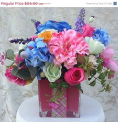 Mothers Day Sale Spring Silk Floral Arrangement in Glass Cube. $20.00, via Etsy.