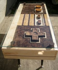 fully-functional nintendo controller coffee table.. super awesome. not for $3,500 tho