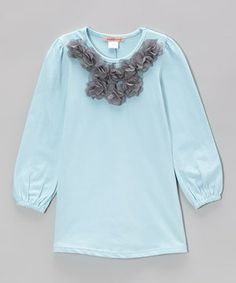 Gathered cuffs and a fluttery front add uniqueness to this dainty tunic. A cotton and spandex blend will keep girls super comfy all day.