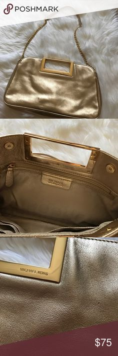 Michael Kors Large clutch with strap Rose gold leather clutch/purse. This bag is really beautiful, small flaws (last photos) were already present at time of purchase. Comes with dust bag KORS Michael Kors Bags Clutches & Wristlets