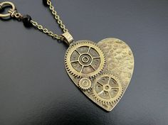 I like this for maybe bridesmaid jewelry   SALE Steampunk Necklace Victorian Jewelry Heart Gears Cogs Wedding Bridal Bride Groom Vampire Black Red Noir Steam Punk Gothic Jewellery. $29.99, via Etsy.