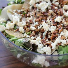 This salad is a lively combination of arugula leaves, fresh pear slices, tangy blue cheese and toasted pecans dressed with balsamic vinaigrette.