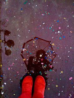 Confetti rain umbrella reflection.    She never knows when she'll need confetti.