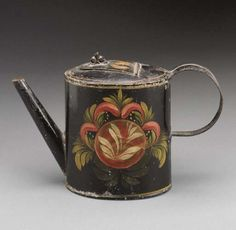 A PAINT DECORATED TOLEWARE TEA POT  PROBABLY PENNSYLVANIA, CIRCA 1830  6in. high