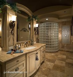 Master bathroom with a tile floor, a glass block shower wall, a very large vanity we would all love to have and plenty of luxurious space. Laundry In Bathroom, House Bathroom, Home, Master Bathroom, Bathroom Vanity Designs, Glass Block Shower, Bathroom Photos, Beautiful Bathrooms, Vanity Design
