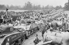 Normandy, June 1944:  Sherman tanks and other vehicles of the 2nd Squadron, 12th Régiment de Chasseurs d'Afrique, French 2nd Armoured Division (2ème Division Blindée or 2e DB) at a marshalling area in Normandy, shortly after landing on Utah Beach on 1 August 1944.
