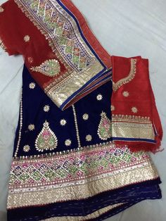 Royal blue and radiant red lehenga in beautiful colorful handwork!
