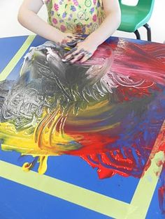 Finger Painting on a table!  then take a print with lying a paper on top of the artwork!