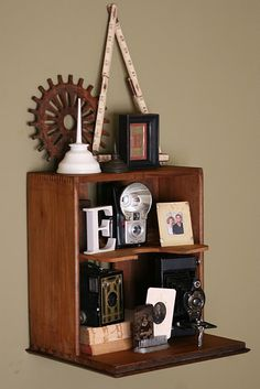 I love this idea of using a very old file cabinet drawer as a shelf on the wall.  Repurpose!
