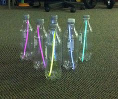 Glow in the dark bowling. Glow in the dark sticks, empty water bottle can and a ball. Pretty simple