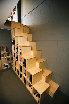 Simple plywood alternating tread stair which provides storage and tests your sobriety. Beautifully crafted by Ackerman Barkle, Queensland.