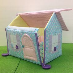This little house is made of soft, bright cotton fabric. With its handle on top, it can be packed up and taken anywhere. Perfect for the car or any kind of travel! Side zippers, velcro on the roof and snap door will also teach your little one how to use different fasteners.  Each house is handmade, and completely unique! A couch, chair and bed with comfy pillow and blanket are all included and fit right inside. The size of the house is 11.5 long x 7.5 wide x 10 high. Because of some small…