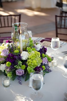 Purple, Green and White Flower Centerpieces: with the oscar in the center