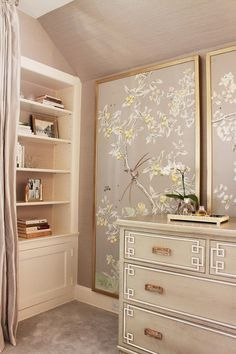 framed Chinoiserie panels on top of the grasscloth wallcovering