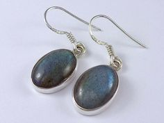 Labradorite sterling silver earrings. Oval design sterling silver earrings set with cabochon labradorite stone, for any occasion.