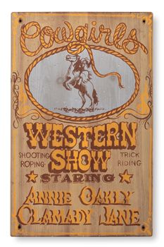 """Log Cabin Decor Sign """"Cowgirls Western Show"""" starring Annie Oakly and Calamity Jane $119.00 at Crow's Nest  would love to hang this in my house"""