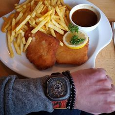 """A German classic """"Schnitzel mit Pommes"""" and sevenfriday with spalding basketball strap.  #handmade #handcrafted #luxury #unique #oneofakind #accessories #watchstrap #straps #fashion #manfashion #strap #bespoke #leather #leathercraft #custom #watch #timepiece #horology #wristcandy #basketballstrap #basketball #sevenfriday #schnitzel #pommes by lionstraps"""