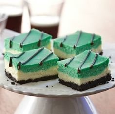 MINT CHOCOLATE CHEESECAKE SQUARES * chocolate cookie crust & drizzle * 3 layers * photo courtesy of McCormick's * perfect for St. Patrick's Day or Christmas