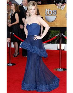 Barrymore offsets a bold blue Monique Lhuillier gown with pale makeup at the 2010 SAG Awards.   - HarpersBAZAAR.com