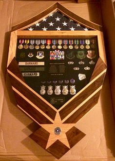Custom made solid oak and walnut inlayed military Air Force MSgt shadow retirement box $300.  If interested in a custom military shadow box, flag case, coin holder, contact Tom @ jenkswood@gmail.com