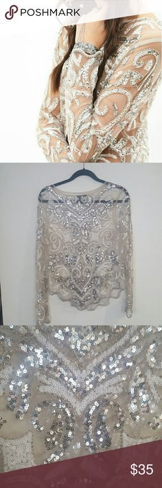 FOREVER21 amazing sequined mesh top Absolutely love it but I have only worn it once. The picture does not make it justice! Please let me know if you have any questions or want to make an offer! Forever 21 Tops Blouses