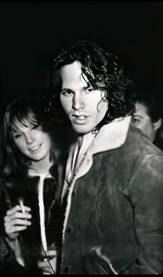 More enhance photos : This one did not come out on Remini like I expected. Jim looks magnificent but Pam is still blurred. It's a free app that's bound to have a flaw or two. lol Jim looks amazing. Photo by … Jim Morrison Death, Jim Morrison Poster, The Doors Jim Morrison, Pam Morrison, Max Miller, Val Kilmer, Pub, Rockn Roll, Janis Joplin