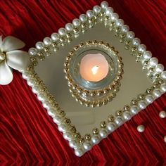 pearl and gold on a mirror for a tealight Thali Decoration Ideas, Diy Diwali Decorations, Festival Decorations, Flower Decorations, Indian Wedding Decorations, Diwali Diya, Diwali Craft, Mason Jar Candle Holders, Candle Holder Decor