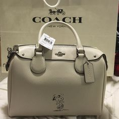 Coach Snoopy This is so CUTE crossbody bag. Color dirty white  new with TAG. My Price is FIRM :) Coach Bags Crossbody Bags