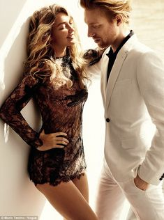 Hard work: Gigi can also be seen in the December issue of Vogue, posing for a racy shoot alongside Star Wars actor Domhnall Gleeson