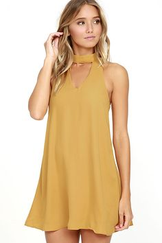 Show 'em how to shake it in the Groove Thing Golden Yellow Swing Dress! A mock neck and front cutout top this flirty swing dress composed of lightweight woven poly. Back keyhole with two top clasp closures.
