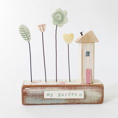 This little hand-painted oak wood hut has a painted door and a garden of clay flowers with a leaf. It sits on a sanded, painted and patterned wooden block and on the front there is a clay plaque with the words 'my garden'. The polymer clay is fired an. Driftwood Crafts, Seashell Crafts, Wooden Crafts, Clay Crafts, Diy And Crafts, Wood Projects, Craft Projects, Projects To Try, Small Wooden House