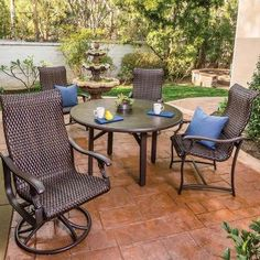 Ravello Woven Outdoor Dining Chairs and Swivel Rockers with a Cabretta Dining Table | Tropitone