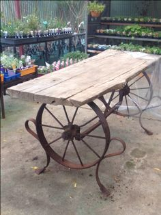 Old wagon wheels coupled with a rustic slab of wood make for a gorgeous table!