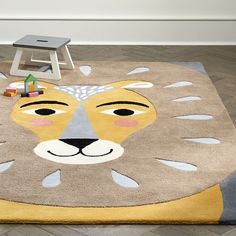 The cutest little lion rug for a gender neutral nursery.