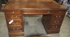 WONDERFUL WOOD OFFICE OR LIBRARY DESK WITH DRAWERS ON EITHER SIDE, TWO OF WHICH ARE FILING DRAWERS. BRASS HARDWARE. MEASURES 30 INCHES TALL, 55 INCHES WIDE AND 25 INCHES DEEP.