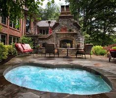twelve person in-ground spa Jacuzzi hot tub; outdoor patio fireplace/pizza oven.