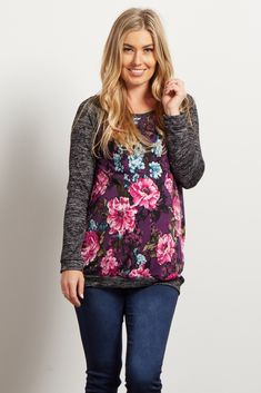 This unique mixed material maternity top will have you wearing nothing else. With its heathered knit sleeves and floral print, this bold top will become your go-to casual day essential. Style it with your favorite maternity jeans and flats for a complete look.