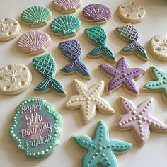 This whole set was so sparkly!!! I did my best to capture them with video but they still were so much prettier in person!  #lovewhatyoudo #sugarcookies #decoratedcookies #mermaidcookies #mermaids #underthesea #birthdaycookies