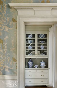 The original molding of the historic home stands out against the new wallcovering in the dining room.