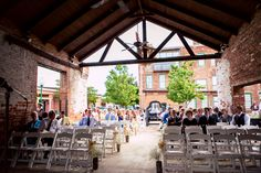 A lovely #rustic #chic #weddinglocation: #EnterpriseMillEvents! #Woodceiling + #brickwalls make for quite a memorable #ceremony #location. ::Angela + Theron's bright summer wedding in Augusta, Georgia:: #augustawedding #georgiaweddings