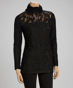 Fashionably flashy, this tunic is brimming with chic style. Allover lace crafts a peekaboo look, while a mock neck adds a fun finish.Measurements (size S): 28'' long from high point of shoulder to hemBody: 95% rayon / 5% spandexLining: 81% nylon / 11% shiner / 8% spandexHand wash; han...